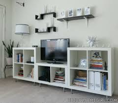 entertainment center makeover with white expedit bookshelves