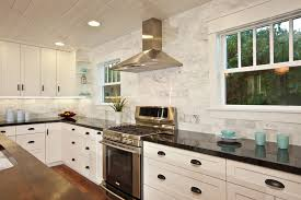 marble tile backsplash kitchen contemporary with black countertops