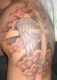 clouds and cross with wings tattoomagz