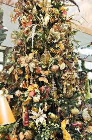 Decorated Christmas Trees In Gold beautiful floral christmas tree decorated in gold trims stock