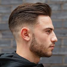 short hair over ears longer in back fade with long slicked back hair and short beard style