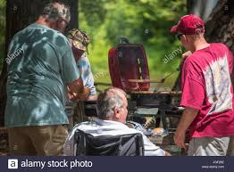 grilling burgers and dogs for a family gathering along the