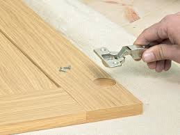 How To Fix Kitchen Cabinet Hinges by How To Install New Kitchen Cabinets How Tos Diy
