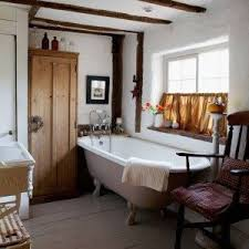 country bathroom ideas with brown cafe curtain and clawfoot tub