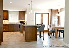 open layout eating nook dining area and kitchen with island in open layout eating nook dining area and kitchen with island in cherry or maple travertine tile backsplash and benjamin moore abalone wall colour
