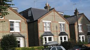 exterior outstanding mansard roof conversion and window