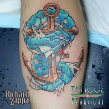 gyarados pokemon with anchor tattoo design for leg by richard zappa