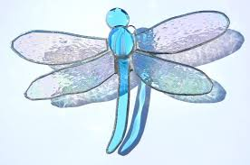 stained glass dragonfly designs shattered by light