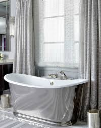 Bathtub Curtains Framing A Free Standing Tub With Curtain Panels