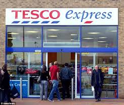 tesco womens boots uk hereford express shop owner paints his signage like tesco express