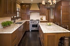 giallo santa cecilia granite kitchen tropical with pendant