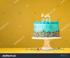 blue buttercream birthday cake colorful sprinkles stock photo