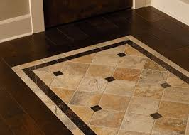 tile inlayed detail in wood floor match the shower to the