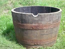 half oak whisky barrel planter with natural bands 63cm diameter