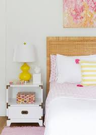 pink and yellow bedroom with campaign nightstand