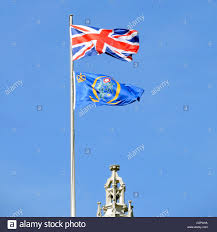 Flag Of The Uk Union Flag And The Emblem Flag Of The Uk Supreme Court Seen Above