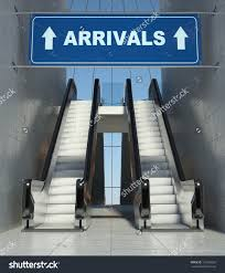 moving escalator stairs in modern airport arrivals sign stock save
