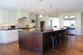 two tone wood kitchen cabinets white painted walls black rectangle