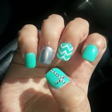 gel nails with chevron design and rhinestone cross i have received