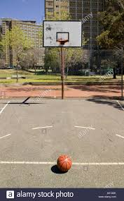 empty outdoor basketball court and a basketball stock photo