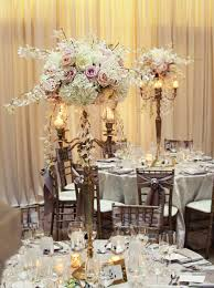 giant gold candelabra centerpieces with lush spray roses