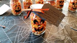 great halloween gifts mason jars made into candy corn pumpkins
