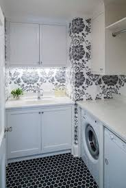 small laundry room with folding table and wallpaper design ideas