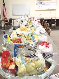 lions club members give thanksgiving baskets to families in need