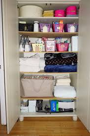 linen closet organizing to make room for kitty heartwork
