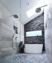 small bathroom with freestanding tub and stone cladding and