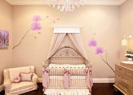amazing baby room with rystal chandelier and cream floral