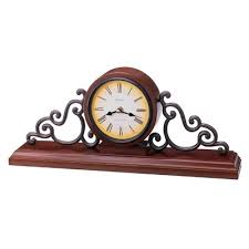 black wrought iron table clock rustic elegance wrought iron fleur de lis table clock with a brown