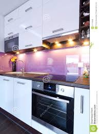 modern white kitchen with spotlights royalty free stock photos