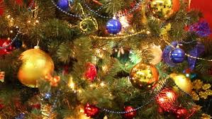 tree with blinking lights golden ribbons and