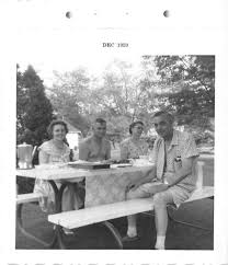 black and white vintage snapshot photograph family picnic bench