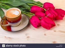 coffee cup with spring flowers for mothers day stock photo