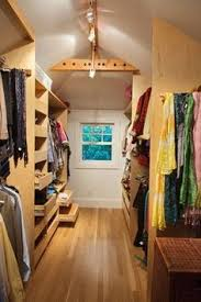 attic storage area converted into a his and her shared walk in