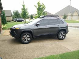 linex jeep cherokee roof cross bars and baskets wind noise and fuel mileage 2014