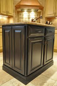 unique distressed painted kitchen island with raised panel drawer