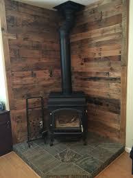 pallet wall behind wood stove tamara house pinterest estufas