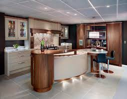 a contemporary kitchen with a curved island kitchens of the day