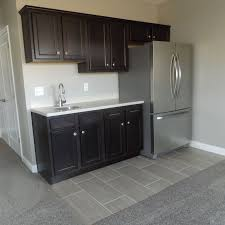 a wet bar and full size fridge in the completed basement provide