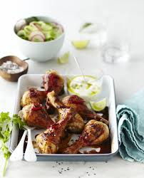 sesame ribbon sticky honey chilli drumsticks served with cucumber