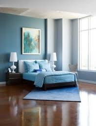 modern cute light blue bedroom with brown floor elegant light