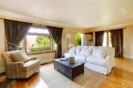 ivory living room with curtained windows hardwood floor room