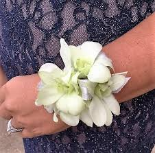 white orchid corsage white orchid classic wrist corsage in st louis mo stems florist
