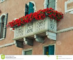 arched window with balcony and flowers royalty free stock