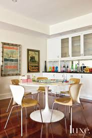 141 best luxe rec rooms images on pinterest rec rooms luxury the saarinen table in the family room occupied the husband s kitchen when he was growing up in toronto also in toronto home interior