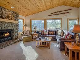 reverse living open floor plan river rock fireplace air