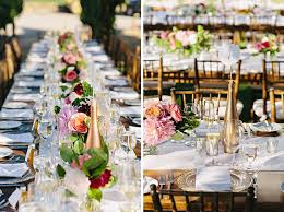 gold wine bottle table numbers low centerpieces down the farm table paired with gold painted wine